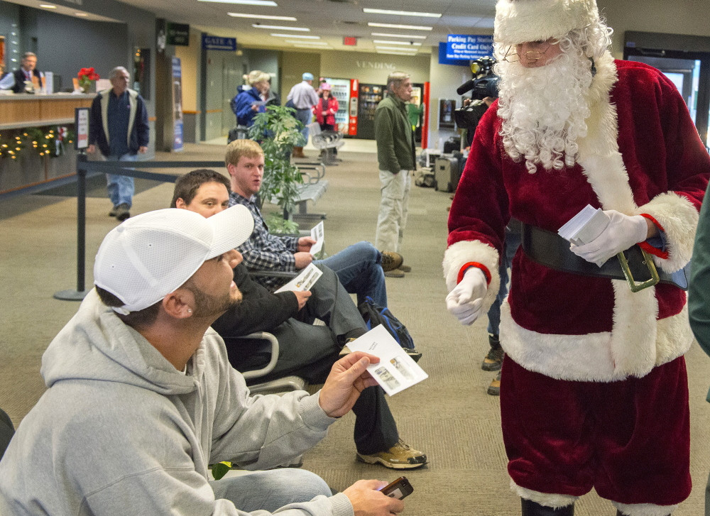 Phil Innis initially thought Secret Santa was an Amtrak employee handing out coupons on Dec. 24, 2014 – until he discovered a $100 bill in the envelope. <em>John Ewing/Staff Photographer</em>