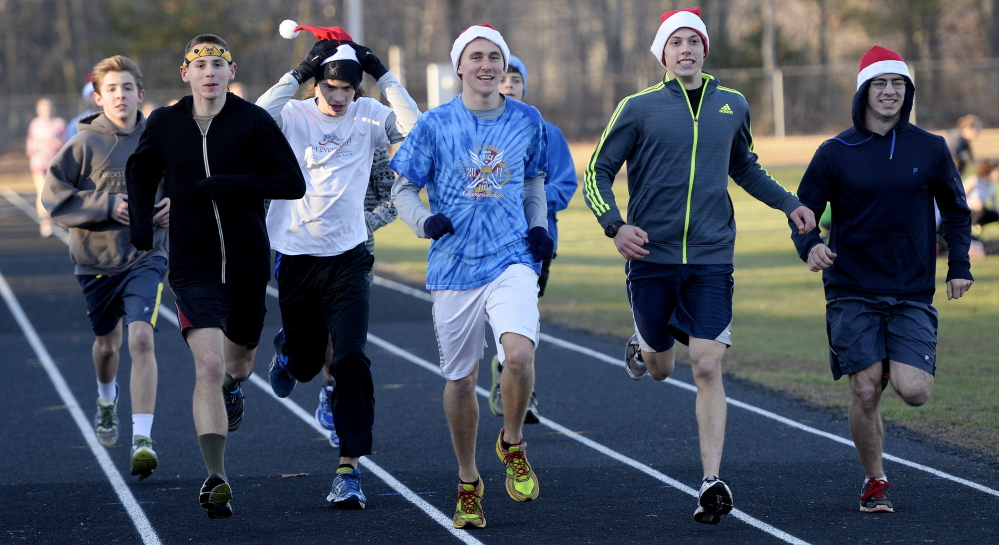 Tucker Corbett, center, has been part of a York High indoor track team that won states titles in his first two seasons and was runner-up last year. One reason is the depth on the team – about 120 students in the indoor program, all overseen by Coach Ted Hutch.