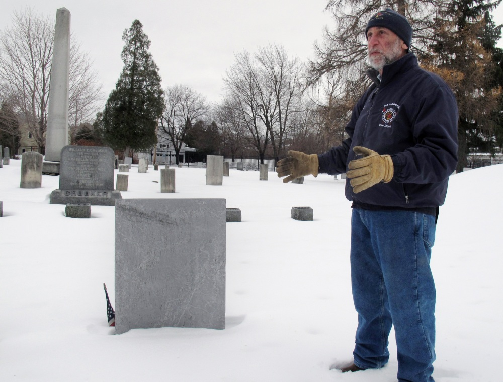 Art Cohn of the Lake Champlain Maritime Museum stands in front of the grave of War of 1812 hero Joseph Barron Jr., in Burlington, Vt. Cohn says the grave was dug up in 1906 to determine whether Barron's remains were really in his home state.