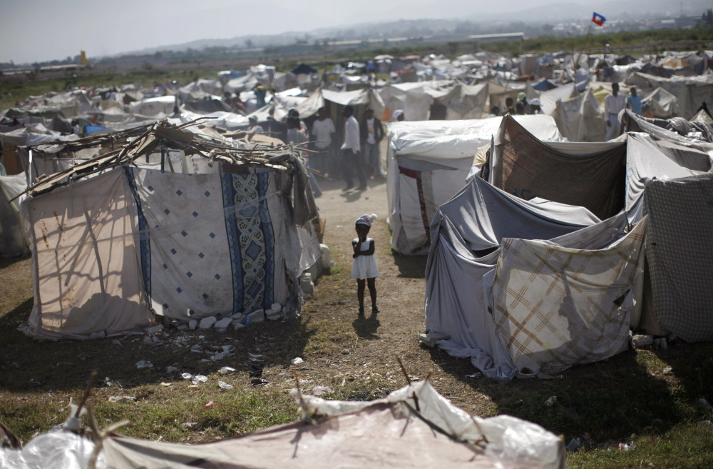 A child stands among makeshift tents at a refugee camp for earthquake survivors in the Cite Soleil neighborhood of Port-au-Prince in 2010, after a magnitude-7.0 quake struck the island and killed an estimated 300,000 people.