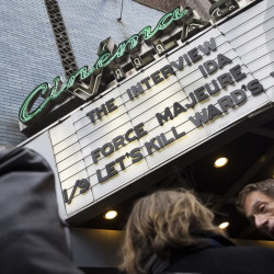 "Patrons wait to see ""The Interview"" at the Cinema Village theater on Thursday in New York. The film's Christmas Day release was canceled over threats of violence linked to North Korea, but it is now showing in some independent theaters and online platforms."