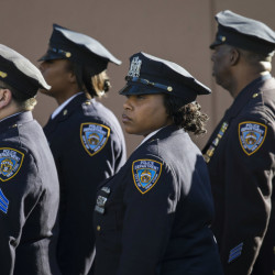 New York police officers arrive at the wake of Rafael Ramos on Friday at Christ Tabernacle Church, in the Glendale section of Queens, where Ramos was a longstanding and deeply committed member.