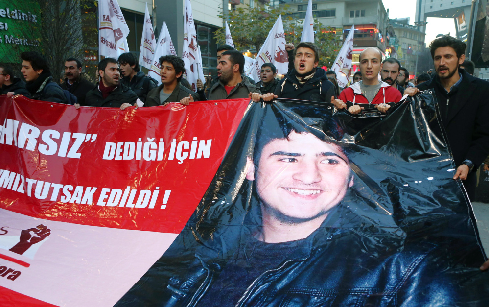 """Students carry a banner with an image of a Turkish teen, known as M.E.A., that reads, """"Our friend was taken prisoner for calling a thief a thief"""" during a protest in Ankara on Friday."""