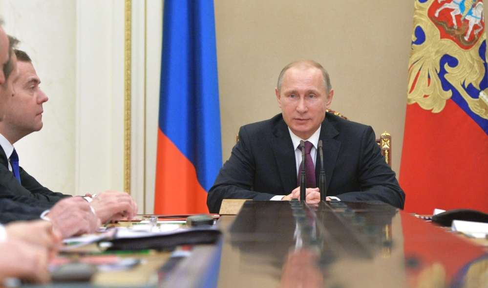 Russian President Vladimir Putin, seen as he heads the Security Council in Moscow's Kremlin on Friday, has signed a new, more aggressive military doctrine. NATO, in response, has denied it is a threat to Russia.