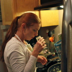Army veteran Katie Weber, a survivor of military sexual trauma who now spends most of her time doing MST advocacy, prepares dinner at home in Santa Rosa, California on Dec. 4.