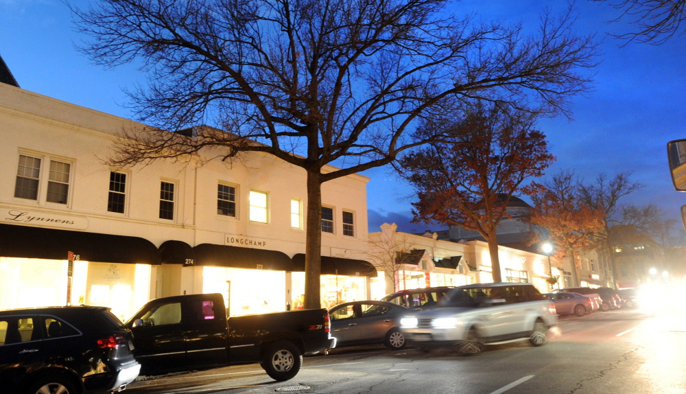 Trees in front of shops along Greenwich Avenue in Greenwich, Conn., were undecorated this Christmas season. Without the lights that usually illuminate trees there, businesspeople and shoppers alike are disappointed.