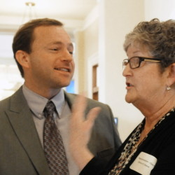 """Speaker of the House Mark Eves chats with Rep.-elect Donna Doore, D-Augusta, before orientation day events for new members of the Legislature on Nov. 13. Eves is urging his caucus to """"put jobs first."""""""