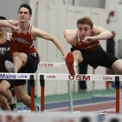 Griffin Madden of Scarborough, right, is followed by his teammate Maxim Doiron as they head to the line for a 1-2 finish Saturday in the 55-meter hurdles at the USM New Year's Relays indoor track meet.
