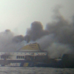 Smoke rises from the Italian-flagged Norman Atlantic ferry after it caught fire in the Adriatic Sea, on Sunday. The ferry carrying some hundreds of passengers caught fire off the Greek island of Corfu early Sunday, trapping passengers on the top decks as gale-force winds and choppy seas hampered their evacuation.