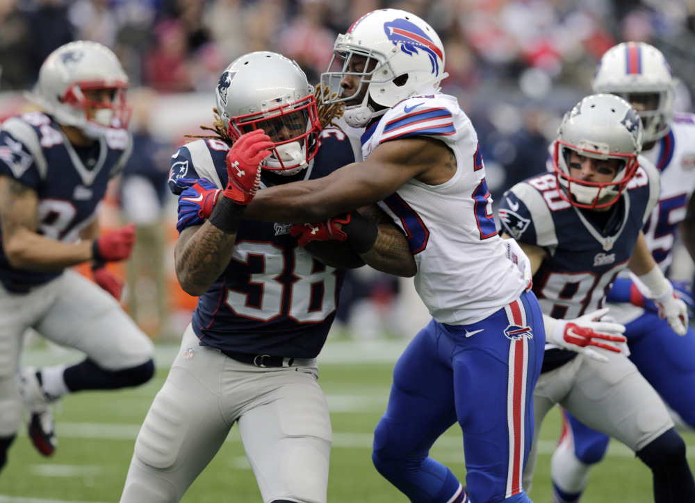 Buffalo Bills cornerback Corey Graham, right, stops New England Patriots running back Brandon Bolden in the first half Sunday in Foxborough, Mass.