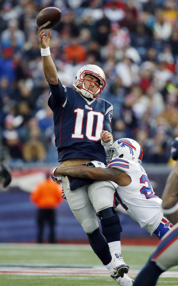 Bills strong safety Duke Williams wraps up Patriots quarterback Jimmy Garoppol. The Associated Press