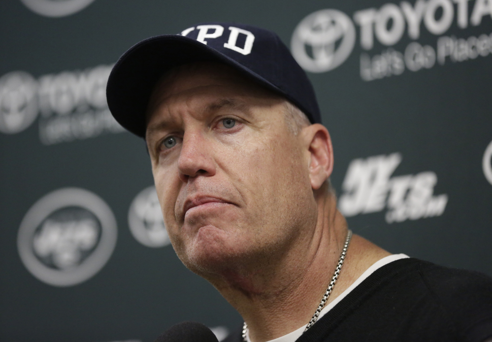 New York Jets head coach Rex Ryan listens to a question during a news conference Sunday after a game against the Miami Dolphins,.