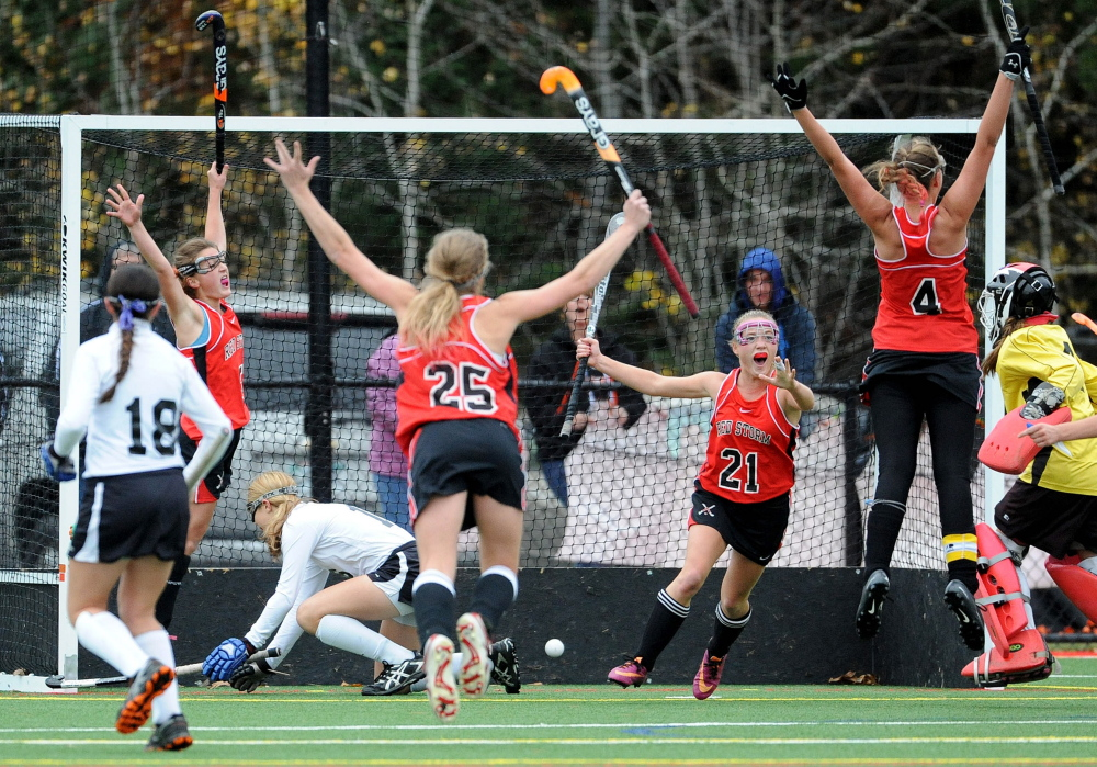 "Kristen Murray, 4, leaps after scoring the winning goal with 2.1 seconds left to beat Skowhegan for the Class A state title last fall in field hockey. ""I think about it every day,"" says Murray. ""It still feels like a dream."""