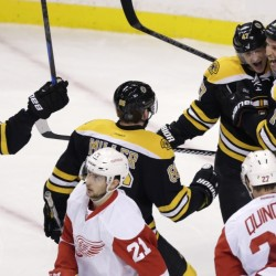 Boston Bruins center Gregory Campbell, right, is congratulated by teammates after his goal against the Detroit Red Wings in the first period of Monday night's 5-2 win in Boston.