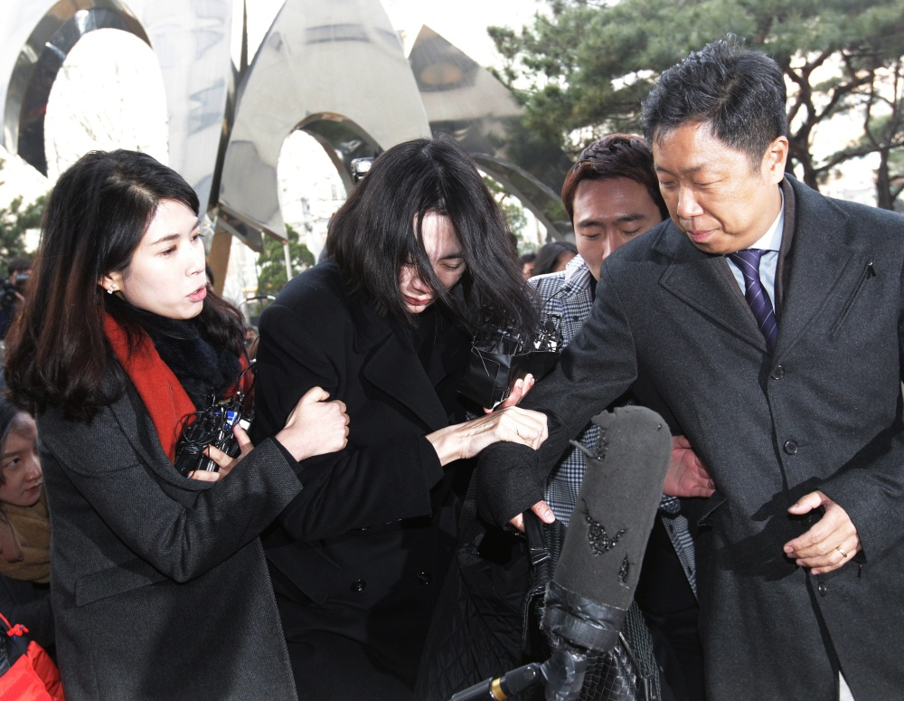 Cho Hyun-ah, center, former vice president of Korean Air Lines, arrives at the Seoul Western District Prosecutors Office in South Korea, on Tuesday. A court is expected to decide whether to arrest Cho in the 'nut rage' case.