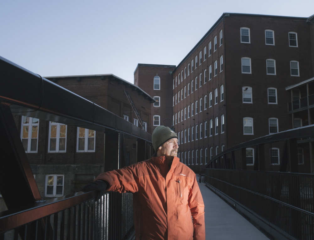 """Saco city planner Bob Hamblen stands on the new pedestrian bridge linking the downtowns of Biddeford and Saco and also the river walks in each city. """"The riverfront is something people are drawn to,"""" Hamblen said. A grand-opening celebration is being planned for May."""