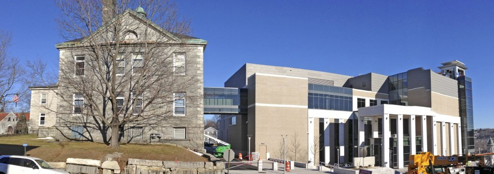 The old Kennebec County Courthouse, at left, will be renovated in the coming months, and construction of the new Capital Judicial Center in Augusta, at right, is nearly complete.