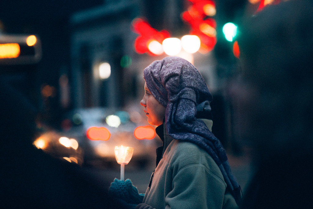 Rachael Ryan holds a candle after marching from the Preble Street Resource Center for a vigil in Monument Square in Portland on Monday evening. Ryan is from Portland and became homeless seven months ago.