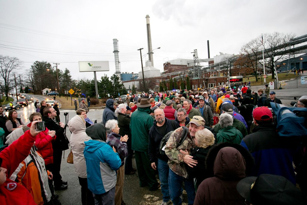 Workers leaving the Verso Paper mill are greeted by hundreds of community members as their final shift ends on Dec. 17. A statement Tuesday said at least $18 million will be paid to 500 hourly workers who lost their jobs when the mill closed.