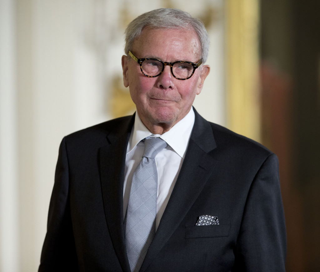 Journalist Tom Brokaw, is introduced before being awarded the Presidential Medal of Freedom, Monday, Nov. 24, 2014, during a ceremony in the East Room of the White House in Washington.  The Associated Press