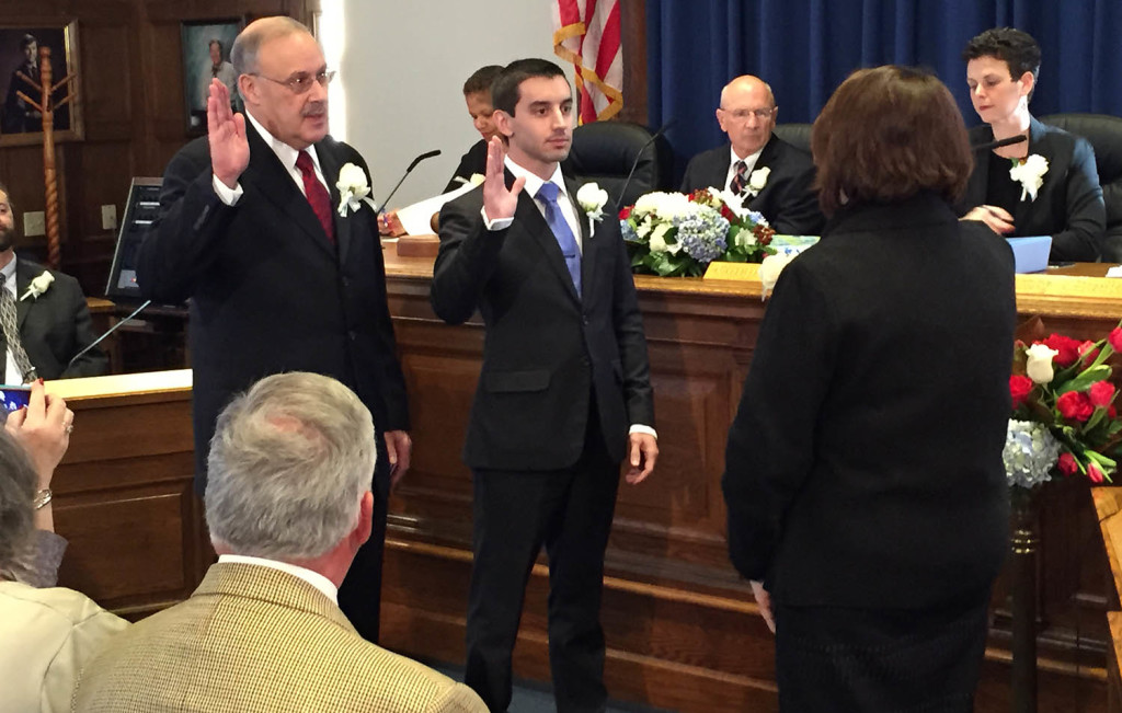 David Brenerman, left, and Justin Costa take the oath of office on Monday to serve three-year terms on the Portland City Council.