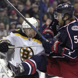 Boston Bruins' Brad Marchand, left, and Columbus Blue Jackets' David Savard fight for position in front of the net during the first period Saturday in Columbus, Ohio. The Associated Press