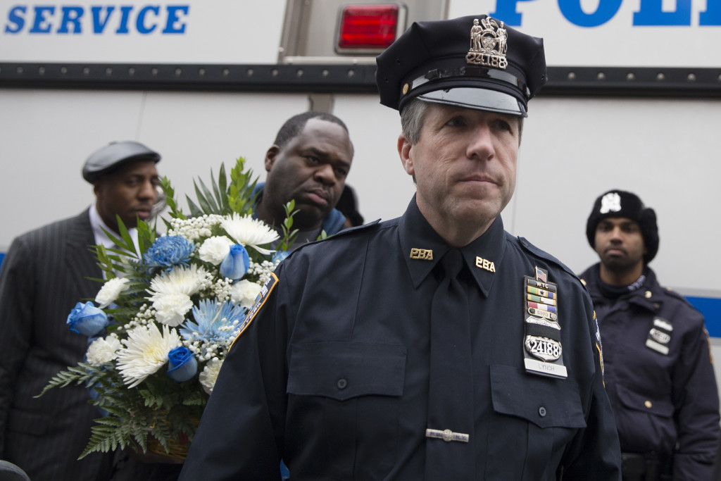 Patrick Lynch, president of the Patrolman's Benevolent Association, arrives at a makeshift memorial near the site where New York Police Department officers Rafael Ramos and Wenjian Liu were murdered in the Brooklyn borough of New York. The Associated Press