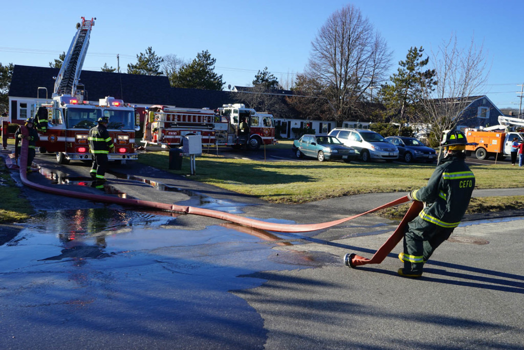 Firefighters work at the scene of a fatal fire on Starboard Drive in Cape Elizabeth on Friday.
