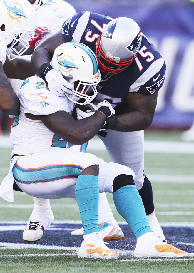 A monster in the midway, New England defensive tackle Vince Wilfork showed Miami running back Lamar Miller the futility of running inside during Sunday's lopsided thrashing of the Dolphins. The Associated Press