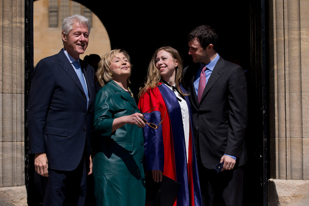 Former U.S. Secretary of State Hillary Rodham Clinton, second left, takes off her sunglasses in this 2014 photograph with her husband former U.S. President Bill Clinton, left, their daughter Chelsea, second right, and her husband Marc Mezvinsky, as they leave after they all attended Chelsea's Oxford University graduation ceremony at the Sheldonian Theatre in Oxford, England.