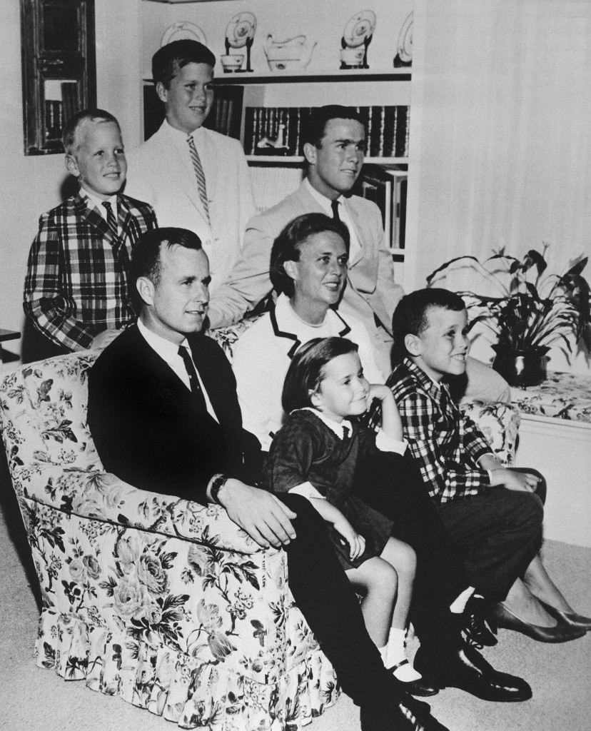 In this 1964 file photo, George H.W. Bush sits on couch with his wife Barbara and their children. George W. Bush sits at right behind his mother. Behind the couch are Neil and Jeb Bush. Sitting with parents are Dorothy and Marvin Bush.