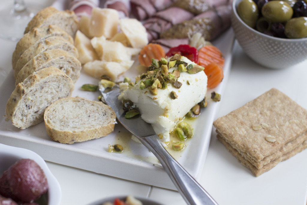 Rosemary-chili marinated goat cheese topped with pistachios.