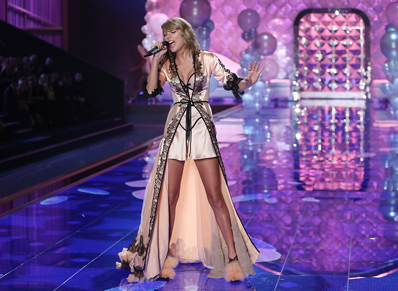 Taylor Swift performs at the Victoria's Secret fashion show in London in this Dec. 2, 2014,  photo. Taylor is nominated for record of the year. Photo by Joel Ryan/Invision/AP