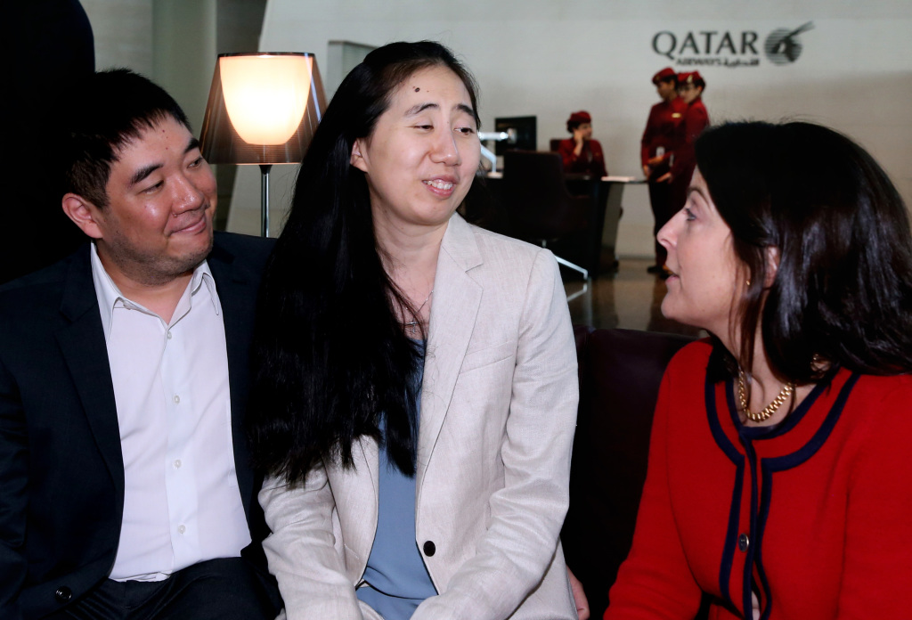 Grace and Matthew Huang speak with U.S. Ambassador to Qatar, Dana Shell Smith, right, at the Hamad International Airport in Doha, Qatar, before their flight's departure Wednesday. The Associated Press