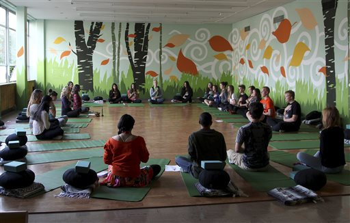 During a class in October, after a half-hour of yoga, students are asked to visualize a stressful moment in their lives and notice the negative internal dialogue in their heads. The Associated Press