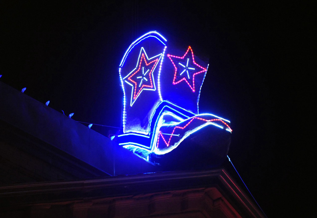 A lighted cowboy boot drop resting on the roof of the Palace Saloon, officially marking the start of the 2014 new year on Whiskey Row in downtown Prescott, Ariz. Televised images every year of New York City's glittery ball drop in Times Square have become inextricably linked with New Year's Eve. But Times Square isn't the only place to ring in the new year with an object dropping from the sky at midnight.