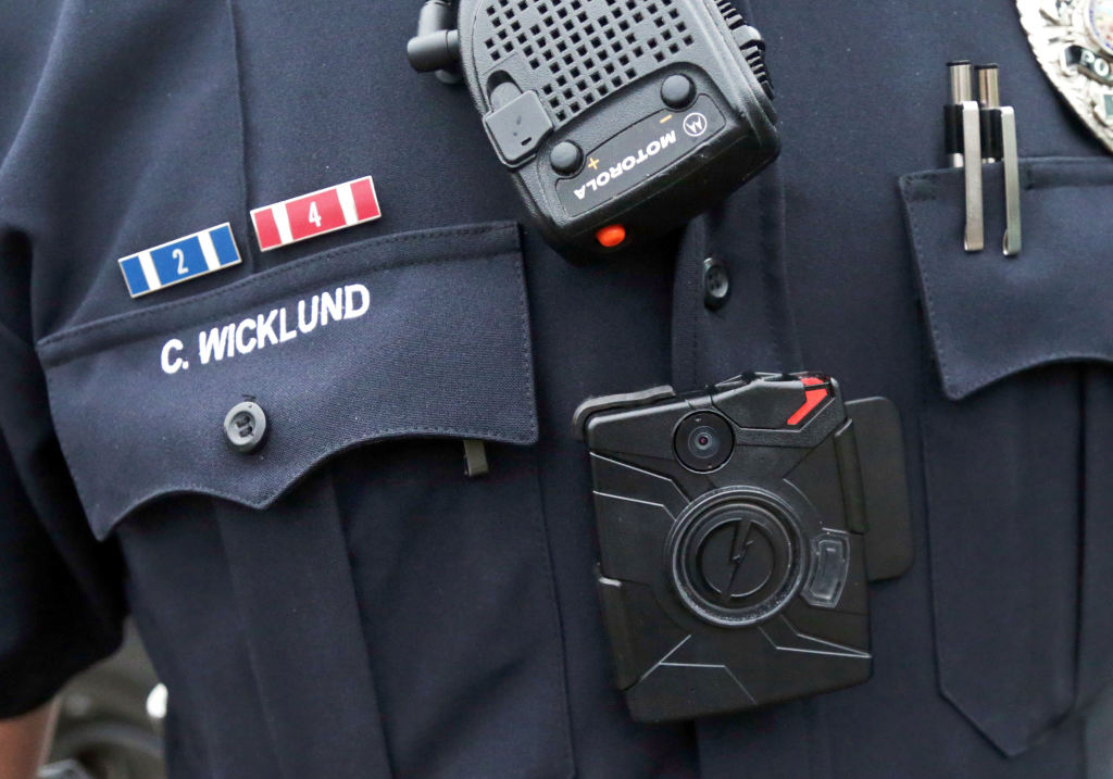 Sgt. Chris Wicklund of the Burnsville (Minnesota) Police Department wears a body camera beneath his microphone. The goal in Burnsville is to have all uniformed offices equipped with cameras by the end of the year. The Associated Press