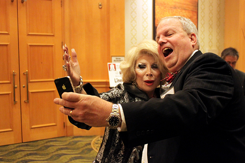 Linda Axelrod (as Joan Rivers) and a fan take a selfie before an event. The celebrity impersonator's business has not slowed down since Rivers' death. Washington Post photo by Jessica Contrera