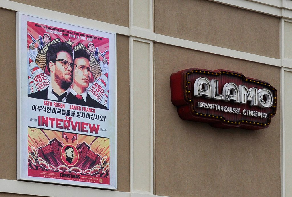 "A large poster advertising the movie ""The Interview"" hangs on the back wall of the Alamo Drafthouse Cinema in Houston on Tuesday. The theater plans to show the film beginning Thursday."