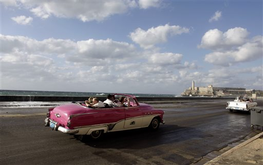 Tourists ride in classic cars along Havana's Malecon in this April 7, 2009, photo. The Associated Press