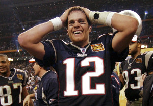 FEB. 1, 2004: New England Patriots quarterback Tom Brady smiles after the Patriots beat the Carolina Panthers 32-29 in the closing seconds of Super Bowl XXXVIII in Houston, a game widely considered one of the best Super Bowls. Brady was named MVP for the second time in three years after completing a record 32 passes for 354 yards and three touchdowns. Kicker Adam Vinatieri again kicked the winning field goal in the final seconds, as he had two years earlier.