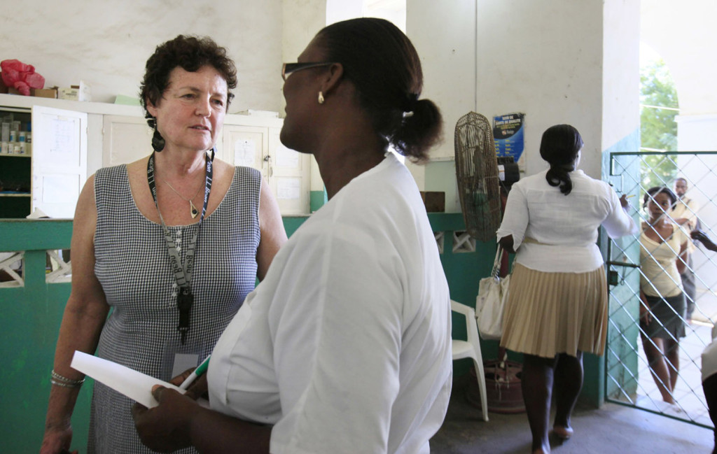 Judy Carl of Portland talks with a nurse at the Justinian Hospital. The Konbit Sante volunteer spent the weekend helping at the hospital, whose emergency room had only a few IV saline units, ibuprofen and acetaminophen.