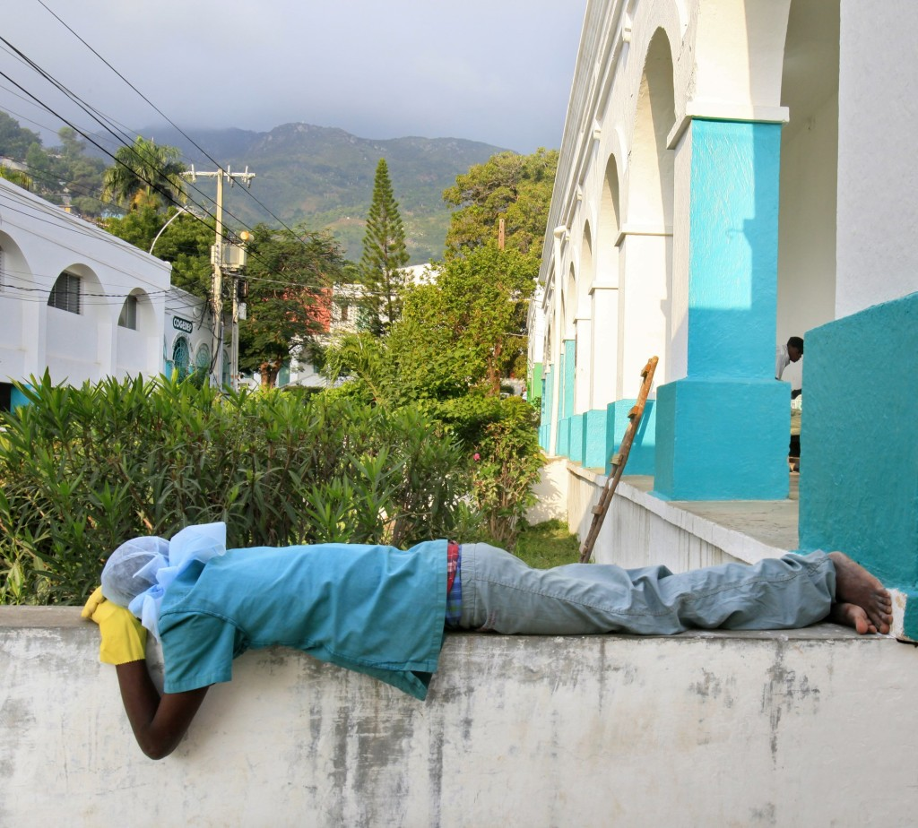 A member of the surgical staff at Justinian Hospital sleeps outside the operating unit early Tuesday. A bus with earthquake victims arrived at 1 a.m., and the surgical staff worked on them all night. Konbit Sante funds 26 positions at the hospital.