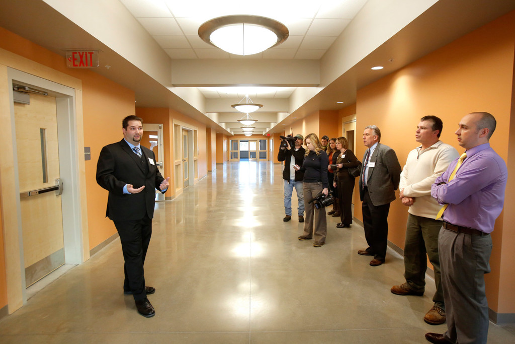 Ken Cianchette, left, project manager with ELC Management, the company that oversaw construction of the building in South Portland that will house offices of Maine's Department of Health and Human Services and Department of Labor, gives a tour of the building on Monday.