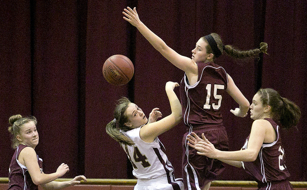 Hayden Campbell (14) of Thornton Academy and Kristen Curley (15) of Gorham, compete for a rebound during a girls basketball game, Monday, as Gorham's Caitlyn Hawxwell, at left, and Emily Esposito, at right, look on.  Gabe Souza / Staff Photographer