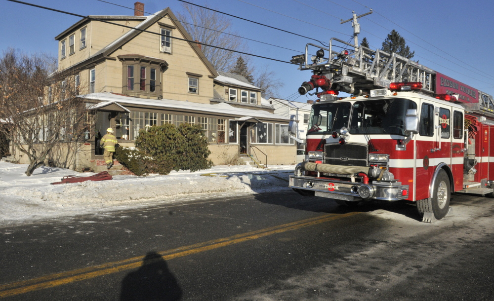 The Winthrop fire department responds to a fire Saturday morning at a four-unit apartment house at 100 Route 133 in Winthrop. Joe Phelan/Kennebec Journal