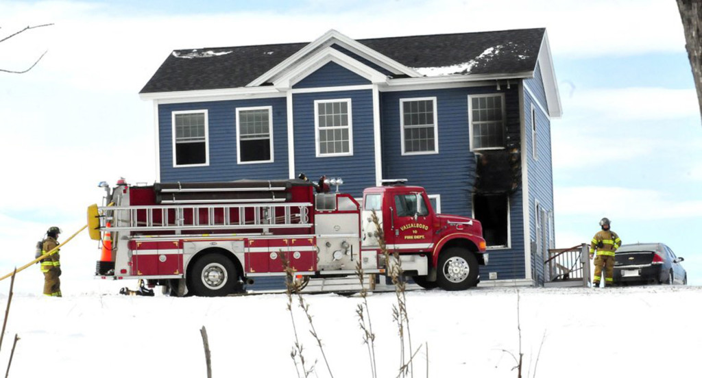 Firefighters from several departments extinguished a fire at a home on Mudget Hill Road in Vassalboro on Wednesday morning.