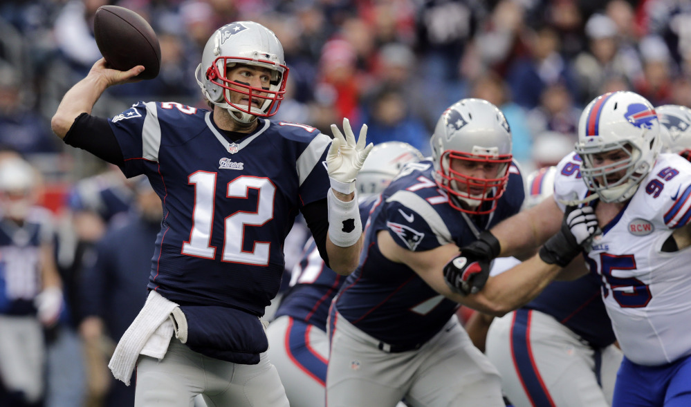 Patriots quarterback Tom Brady, left, now knows how hard it is to win a championship. He's got another excellent chance this season but will have to guide better offensive performances in the playoffs than he did in a loss to Buffalo on Dec. 28.