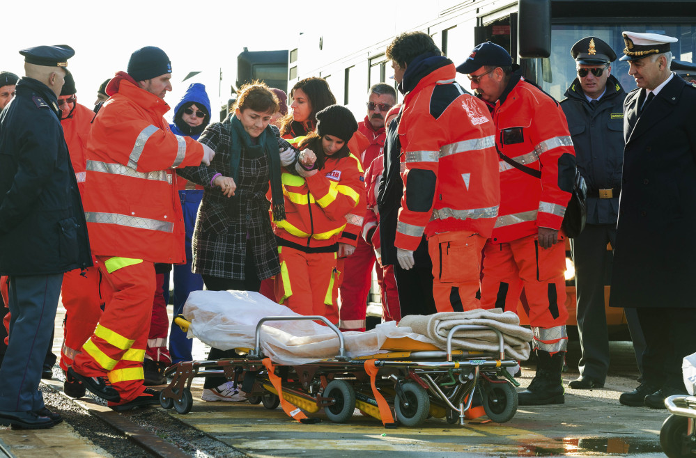 An injured passenger is eased to a stretcher as she and other survivors of the Norman Atlantic ferry fire finally stepped ashore in Taranto, Italy, on Wednesday.