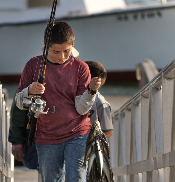 Starting Thursday, nonresidents younger than 16 – like these summer visitors to Islesford from Austin, Texas – will be able to fish for free in Maine. Previously, kids had to be 11 or younger to qualify.